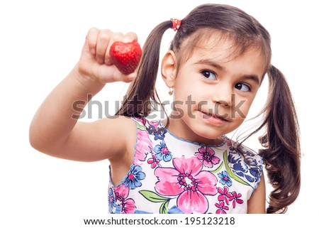 young girl on white background holding a strawberry