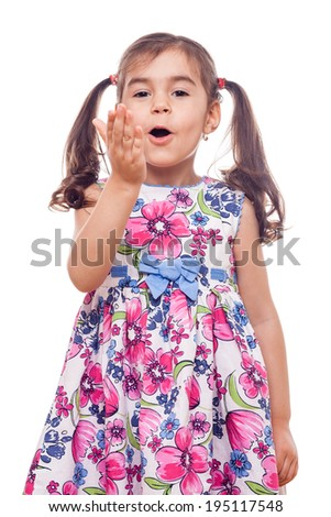 young girl on white background waving at camera