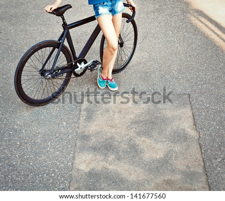 Young girl outdoor with bike - stock photo