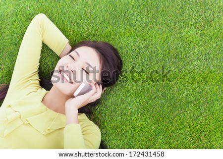young girl outside communication with mobile phone - stock photo