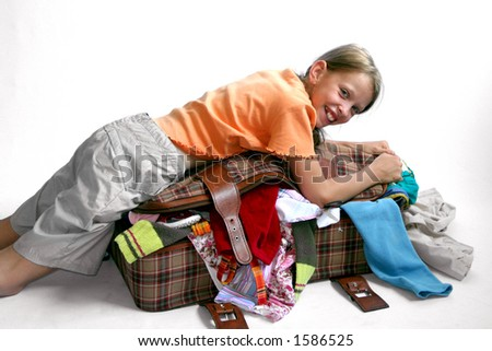 Young girl packing