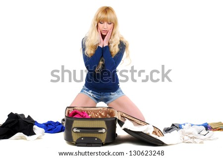Young girl packing for vacation - stock photo
