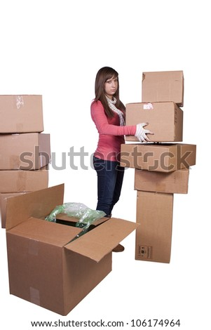 young girl packing up and moving - white background - stock photo