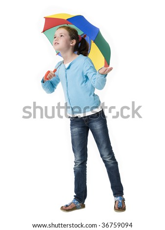 Young girl peering out from under colorful umbrella