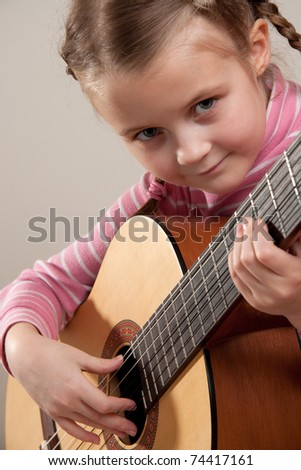 Young girl play classical guitar