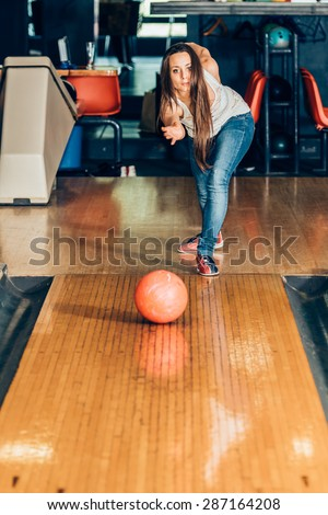 https://thumb1.shutterstock.com/display_pic_with_logo/1246552/287164208/stock-photo-young-girl-playing-bowling-287164208.jpg
