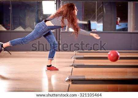 young girl playing bowling - stock photo