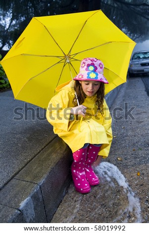 Young girl playing in rain 2 - stock photo