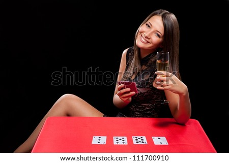 young girl playing in the gambling on black background - stock photo