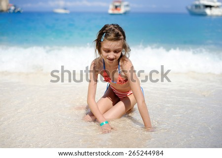 Young girl playing in the wave on the beauty beach