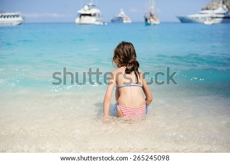 Young girl playing in the wave on the beauty beach - stock photo