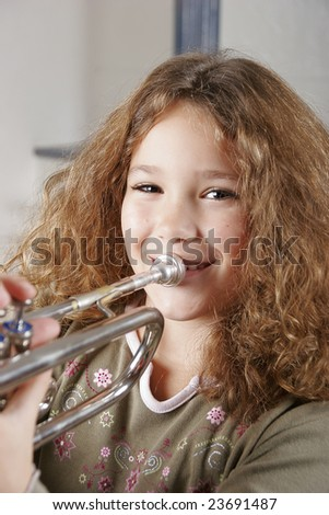 young girl playing trumpet