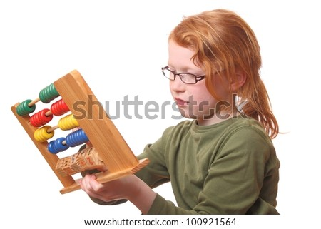 Young girl playing with an abacus on white background - stock photo