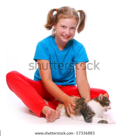 Young girl playing with cat. - stock photo