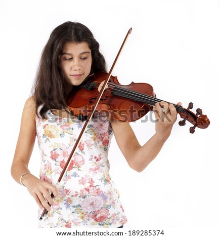 young girl plays the violin - stock photo