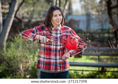 Young girl pointing at the red balloon horizontal - stock photo