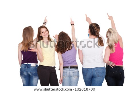 Young girl pointing in copy space above  them - stock photo