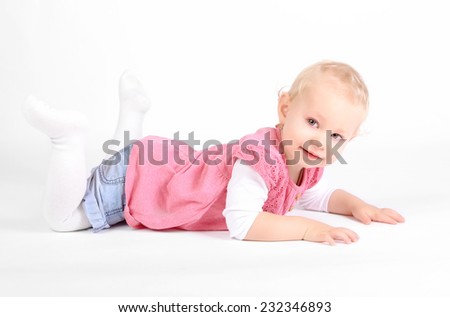Young girl poses for a picture on white background