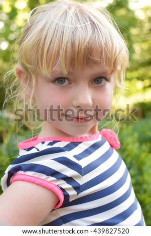 young girl posing for headshot in bathing suit - stock photo