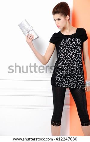 young girl posing holding purse posing in studio - stock photo