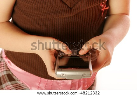 Young girl posing on isolated background holding a cell phone - stock photo