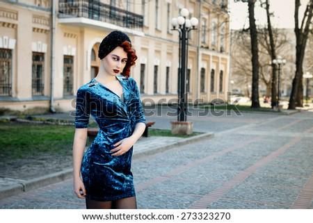 Young girl posing on street - stock photo
