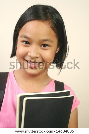 Young girl posting with a book. - stock photo
