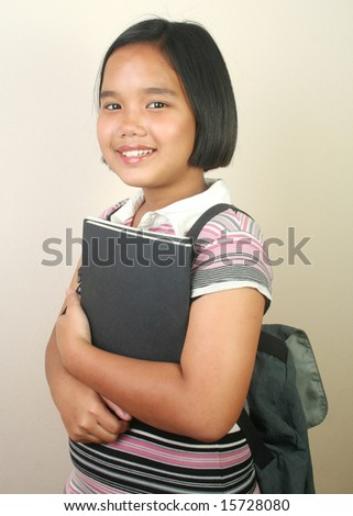 Young girl posting with a book.