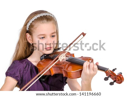 Young girl practicing the violin. Over white background.