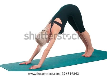 Young girl practicing yoga with gymnastic mat