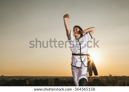 Young Girl Practising Wushu at Sunset