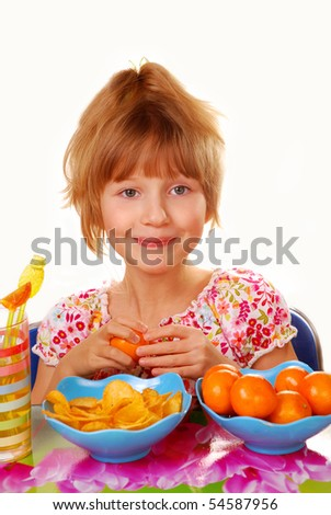 young girl preferring to eat fruits than chips