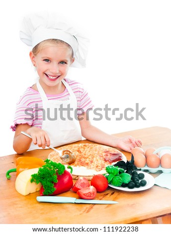 Young girl preparing a pizza on a white background