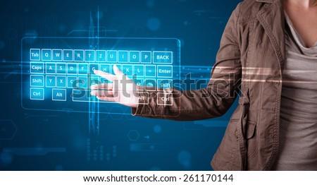 Young girl pressing virtual type of keyboard - stock photo