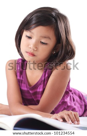 Young girl reading a book.Isolated in white background.