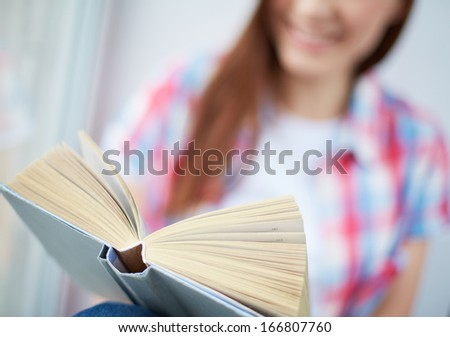 Young girl reading book - stock photo