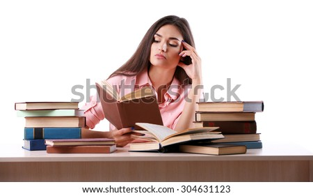 Young girl reading book isolated on white