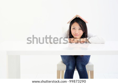Young girl reading with book - stock photo