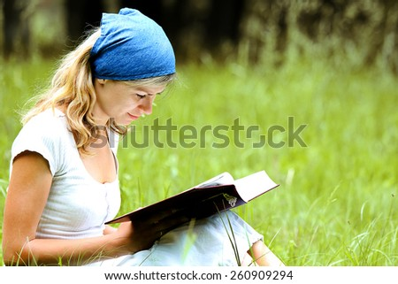 young girl reads the Bible - stock photo