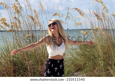 Young girl relaxing and happy to be on vacation in Florida. - stock photo