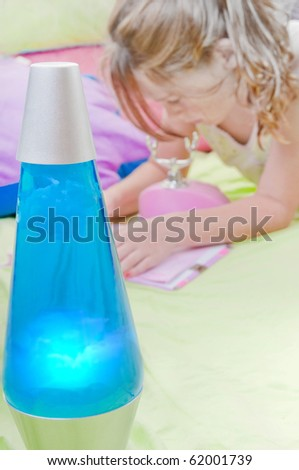 Young girl relaxing in room by funky light - stock photo