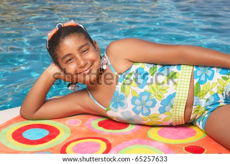 Young girl relaxing on a towel