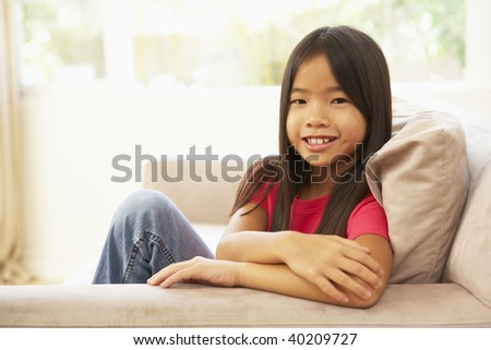 Young Girl Relaxing On Sofa At Home - stock photo