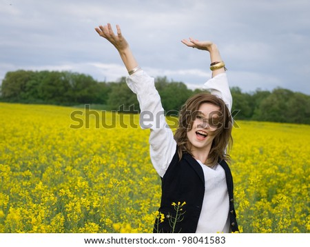 young girl resting in rapeseed field