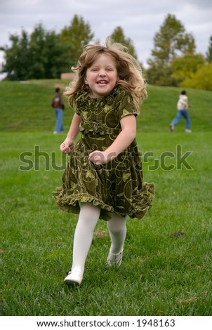 young girl running in park - stock photo