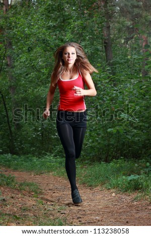 Young girl running in the park - stock photo