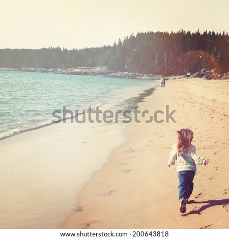Young girl running on beach with instagram effect