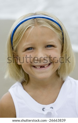 Young Girl's Toothless smile - stock photo