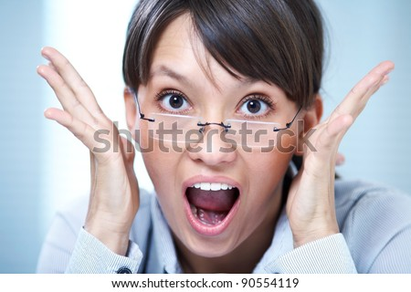 young girl screaming in terror raised his hands - stock photo