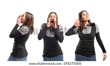 Young girl shouting and listening over isolated white background